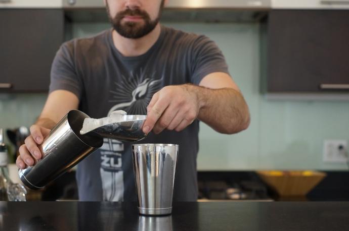 Step 5 of 6: Fill shaker 2/3 with ice.Shake vigorously